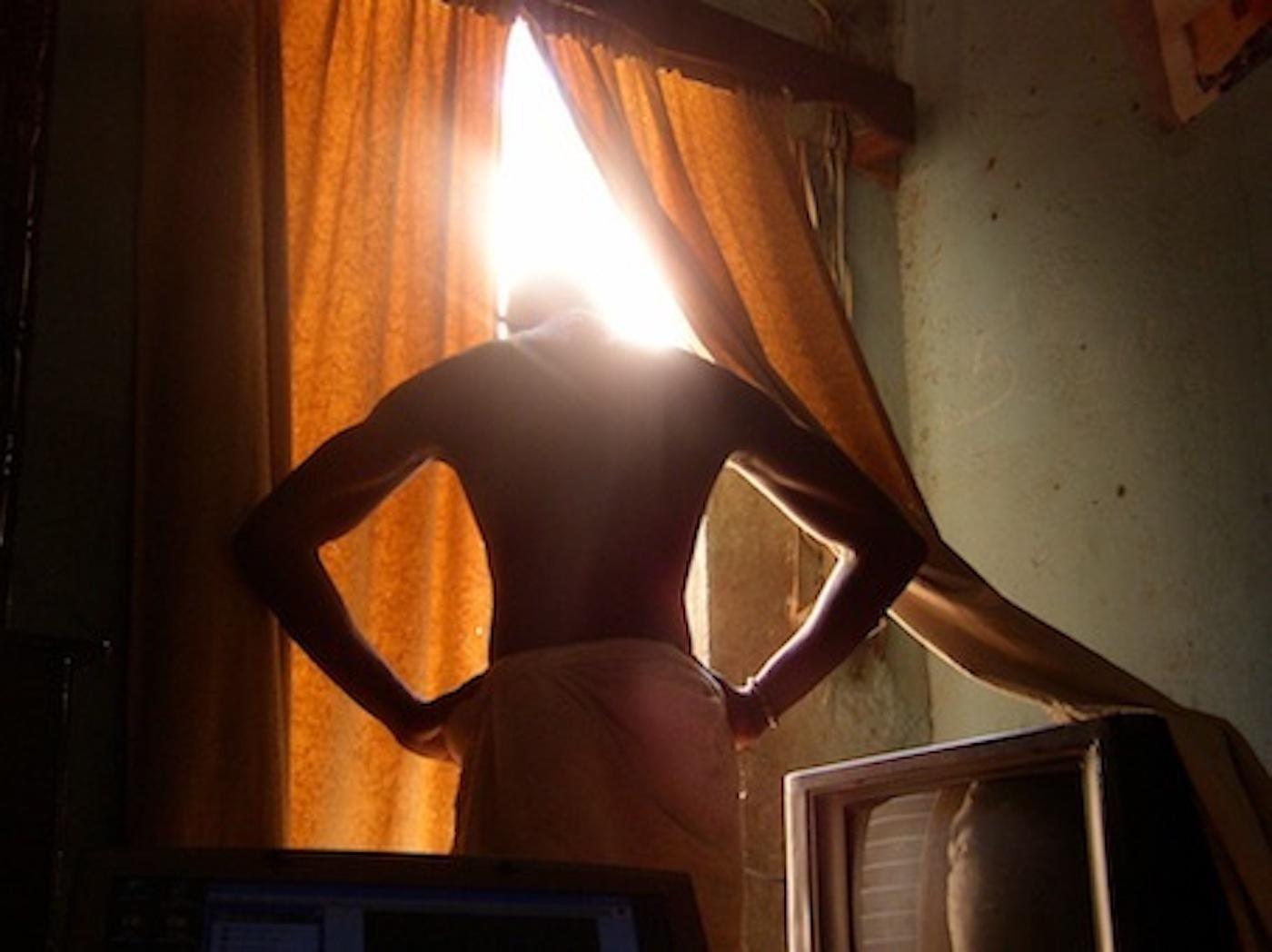 "Mohamed Camara, ""Certains matins, j'ai la tête dans le cul"" 2006/7,digital c-print,  48 x 58 cm. (framed),"